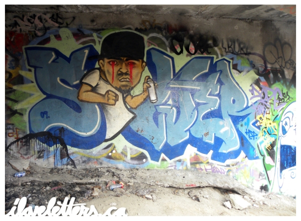 SEWER WALL MONTREAL GRAFFITI